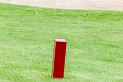The red distance marker pole to inform range of golfing with blu Stock Photography