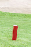 The red distance marker pole to inform range of golfing with blu Royalty Free Stock Photo