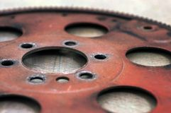Red distressed flywheel Royalty Free Stock Photo
