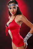 Red diva. Cute brunette in red nightclub outfit Stock Images