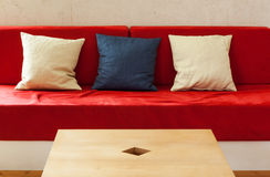 Red divan. Modern interior, living room, detail divan royalty free stock images