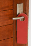 Red Do not disturb label on the door Stock Photos