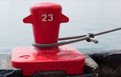 Red Dock cleat securing a ship Stock Images