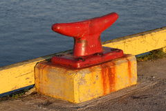 Red Dock Cleat with Yellow Base Royalty Free Stock Image