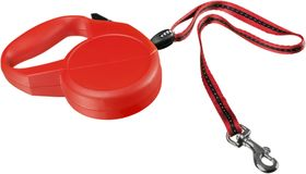 Red retractable leash for dog isolated on white royalty free stock photos