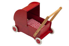 Red dolls pram with doll Stock Photos