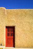 Red Door. Of Adobe house