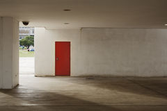Red Door. Mysterious red door in a white wall Stock Images