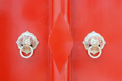 Red door. Open the door handle a couple gold Royalty Free Stock Images