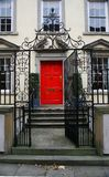 Red door. On luxury townhouse Royalty Free Stock Photo