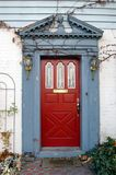 The red door. Red door of a old house stock images