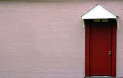 Red Door. A red door and a pink wall Stock Photography