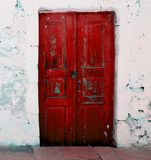Red door. A red door set in a stone wall Royalty Free Stock Photos