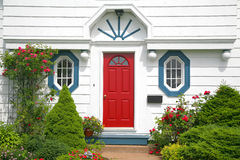 Red Door. A bright red door on the entrance of a home royalty free stock images