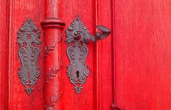 Red door. Red old door, with very beautiful latch. Free space for text on the right side Royalty Free Stock Image