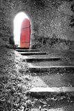 Red Door. Selective colour shot of old red door in old stone brick wall with steps leading up to it, taken at Arundel Castle in England stock images