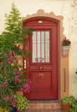 Red door. A nice view of a colored door in provence Stock Images