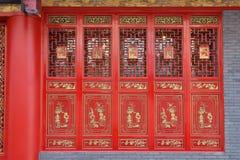 Red door. Traditional red door with golden design from east world stock image