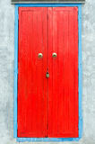 Red door. With the key in the lock Stock Photo