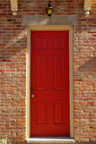 Red door. Way with old fashioned lantern above Royalty Free Stock Image