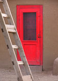 Red door. And a ladder Stock Photos