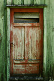 Red Door. Wooden door on an old house royalty free stock photo