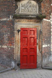 Red Door. In old brick building on streets of Amsterdam Stock Images