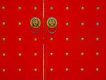 The Red Door. Chinese door with lion heads stock images