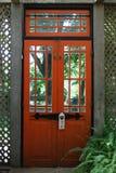 Red Door. Traditional red door through to garden Royalty Free Stock Photo