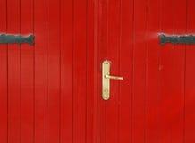 Red door. With metal lock Stock Photo