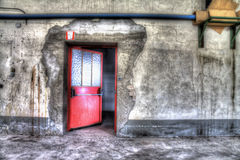 Red door. Abandonned in a kitchen factory Royalty Free Stock Photo
