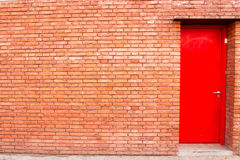 red door in a brick wall Royalty Free Stock Image