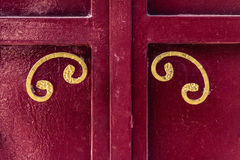 Red door. An antique and stylish metal door in italy Royalty Free Stock Images