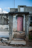Red Door. Architecture in Havana, Cuba.  Crumbling structure framing a beautiful red door Royalty Free Stock Photos