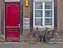 Red door and bicycle stock photos
