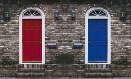 Red Door Blue Door. A pair of colored entry doors to a residence - red door and blue door Royalty Free Stock Photography