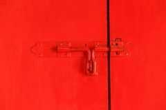 Red door with bolt Stock Image