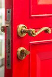 Red door with bolt Stock Images