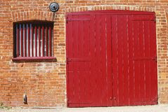 Red door in brick wall. Dell Quay. UK Stock Photos