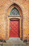 Red door in brick wall Royalty Free Stock Photo