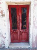 Red door in burano Royalty Free Stock Images