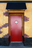 Red door with canopy Stock Image