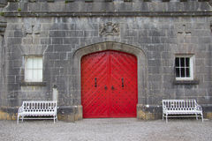 Red door. Of a castle Stock Photos