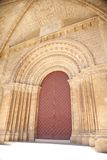 Red door of cathedral at Lleida city Royalty Free Stock Photo