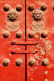 Red Door With Chinese Lions Royalty Free Stock Photos