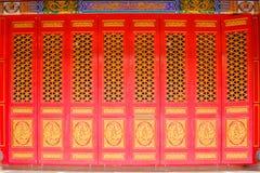 Red door chinese style temple at Wat Mangkon Kamalawat or Wat Leng Noei Yi in Nonthaburi,Thailand. Royalty Free Stock Images