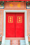 Red door of chinese temple in Thailand. Royalty Free Stock Photography