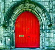 The Red Door. Of a Church in England.  A beautiful little country church that beckons you walk through those red doors and say a prayer. The church is used for Royalty Free Stock Photo