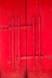 Red door of church with wood latch Thai traditional style, antique wooden door Buddhist temple Stock Photography