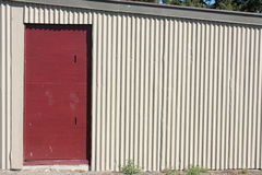 Red door in corrugated iron shed Stock Photography
